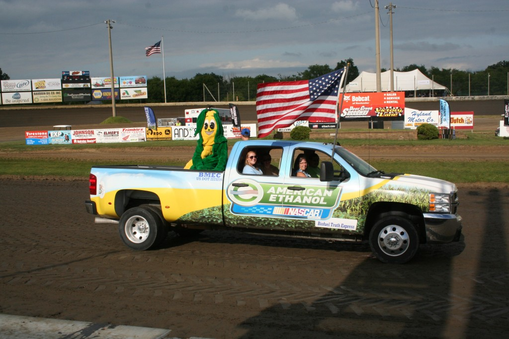 Minnesota Corn Research & Promotion Council member Scott Winslo (who also farms in Fountain, Minn.) drove the American Ethanol truck around the Deer Creek track during the national anthem. Yes, that's Ted Tassel in the back!