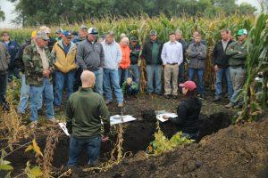 Talking soil health on Bryan Biegler's farm near Lake Wilson.